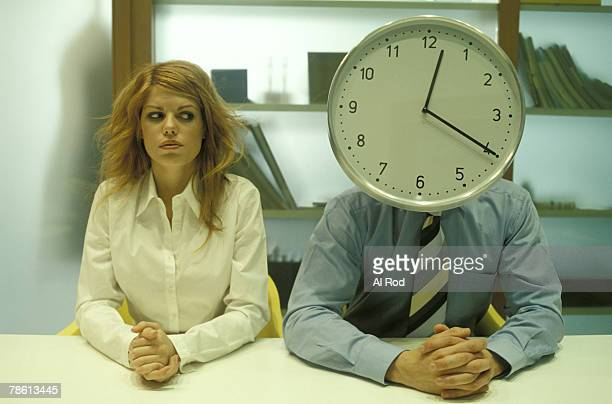 Woman and man with clock for head