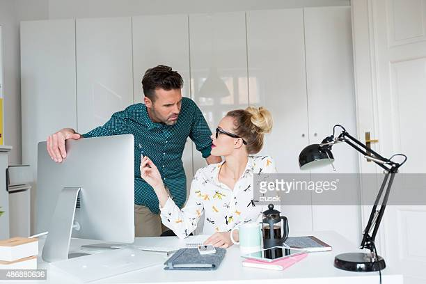 Woman and man working in an office
