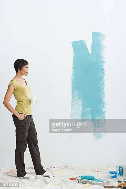 Woman and paint on wall