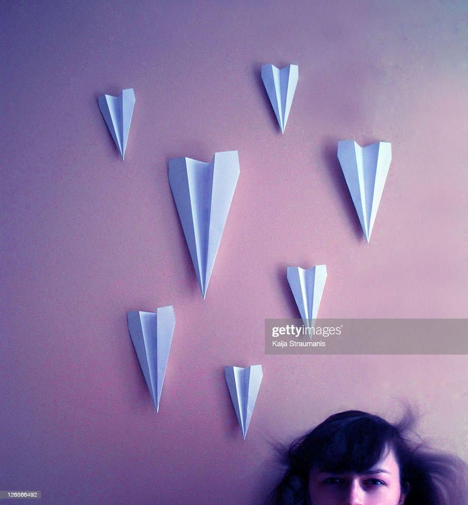 Woman and paper planes : Stock Photo