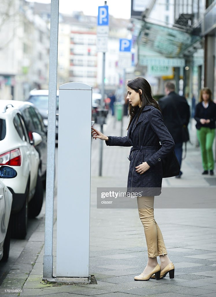 Woman and parking meter