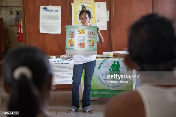 Santa Domingo Dominican Republic November 29 2012 A woman and probably her husband participating at a educational lesson for pregnant women which is...