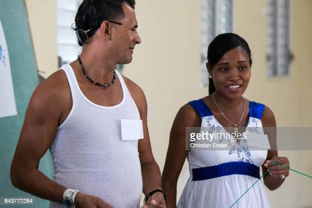 Santa Domingo Dominican Republic November 29 2012 A woman and probably her husband participating at a group game in a educational centre for pregnant...