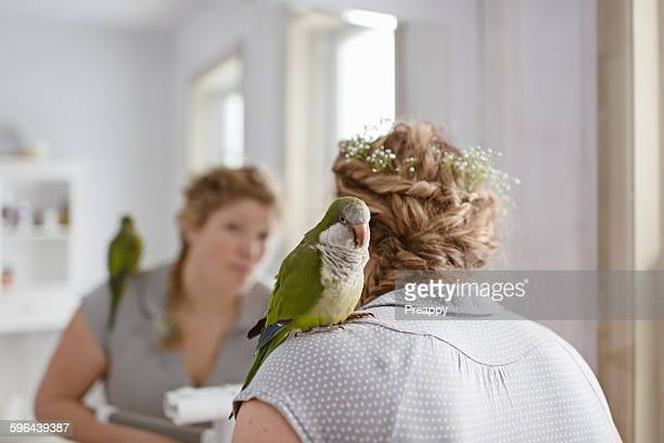 Woman and Quaker parrot