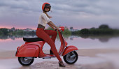 beauty woman with red vintage italian scooter