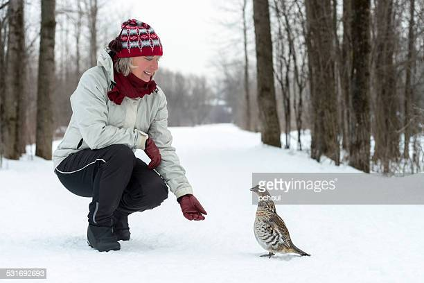 Woman and Ruffed Grouse in winter
