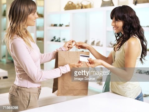 Woman and sales assistant