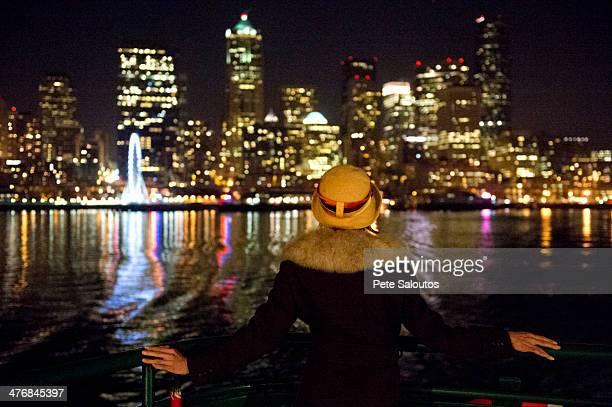 Woman and Seattle skyline at night, Washington, USA