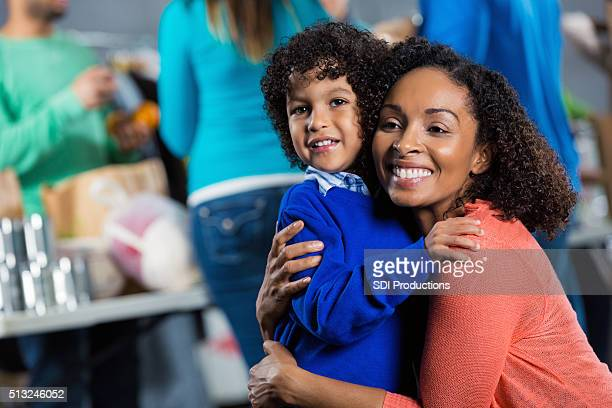 Woman and son at food and clothing drive