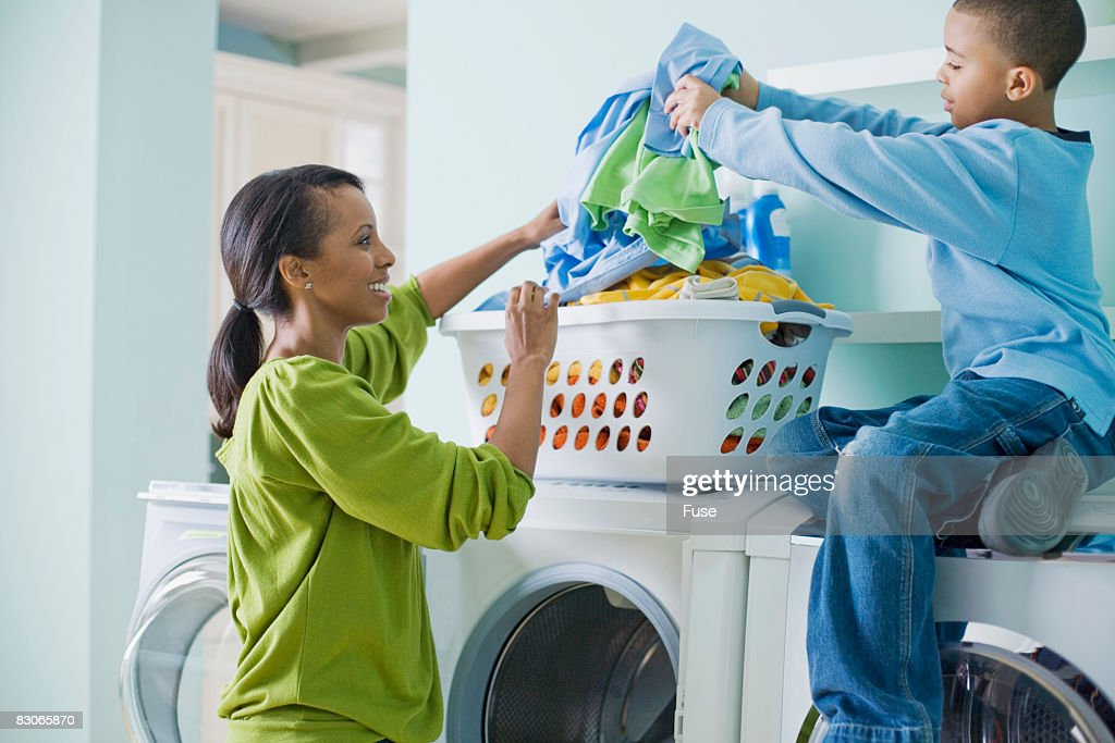 Woman and Son Doing Laundry