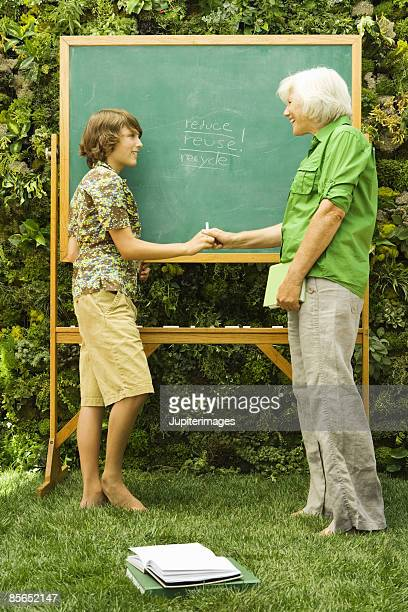 Woman and teen boy at chalkboard