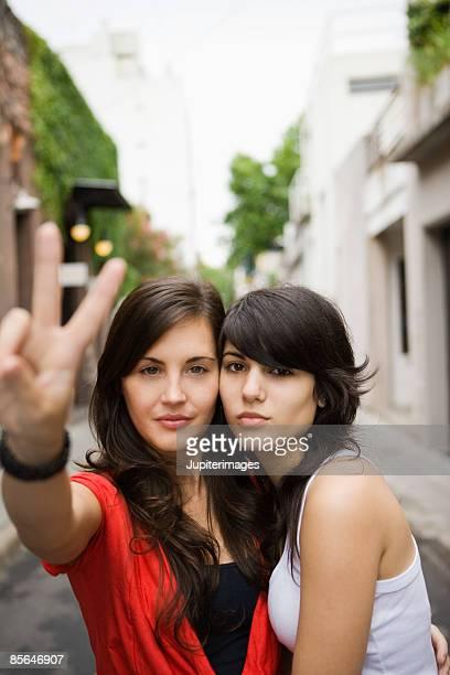 Woman and teenage girl posing