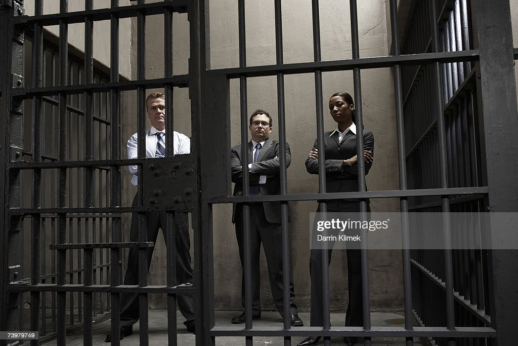 Woman and two men in prison cell, portrait : Stock Photo