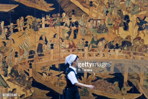 Woman and wall mural in tokyo stock photo getty images for Construction site wall mural