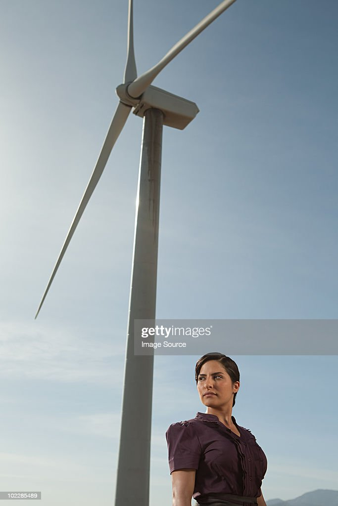 Woman and wind turbine : Stock Photo