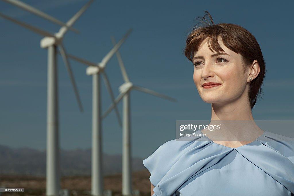 Woman and wind turbines : Stock Photo