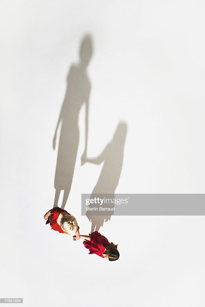 Woman and young girl holding hands : Stock Photo