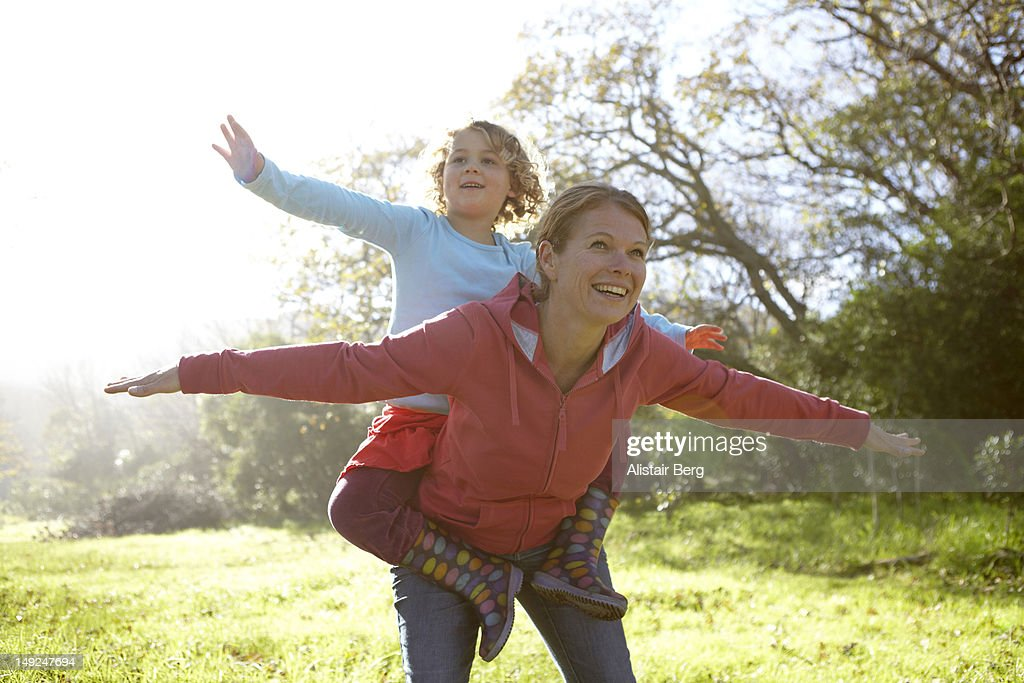 Woman and young girl playing on country walk : Stock Photo