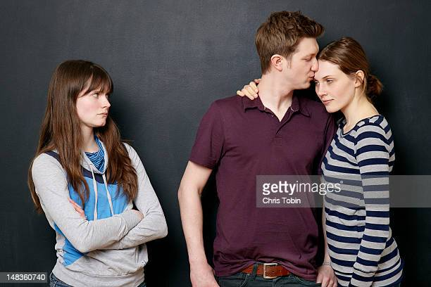 Woman angry at couple in love