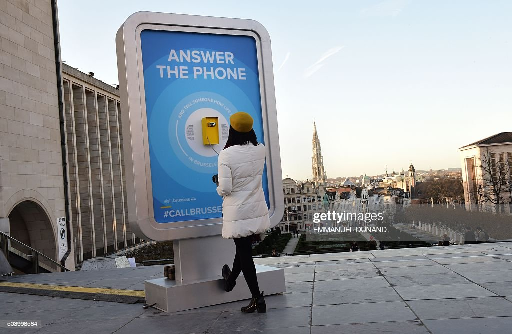 a woman answers a phone a call box to which internet surfers from pictures getty images. Black Bedroom Furniture Sets. Home Design Ideas