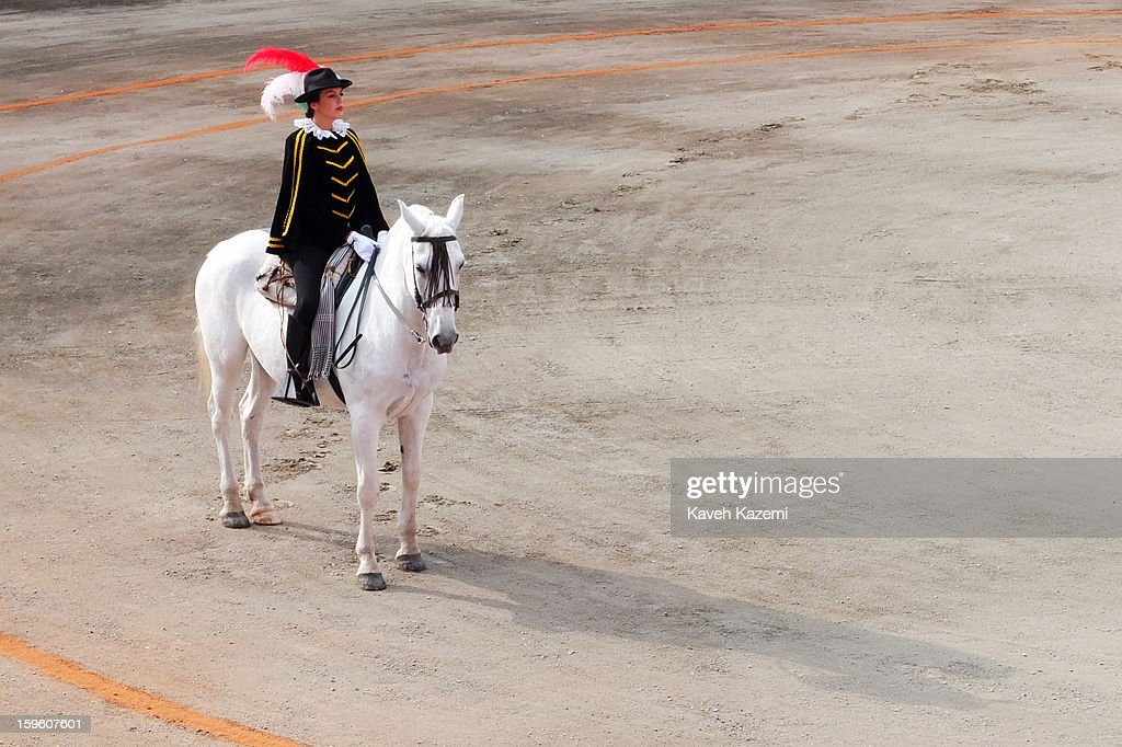A woman appears on the horse during the opening ceremony of the bullfighting during the annual fair on January 11, 2013 in Manizales, Colombia. The festival, is hosted in the city of Manizales in Colombia's central coffee region. Starting out as a trade fair, it has grown over the years to become one of Colombia's most important annual events.