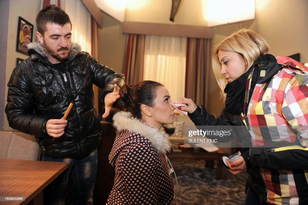 A woman applies make-up on Turkish actress Songul Oden during an interview on February 6, 2013, in Istanbul. Oden played in ''Gumus'' (Silver), a popular Turkisk TV drama, launched in 2005 and whose final episod was watched by over 85 million people from Morocco to Syria.