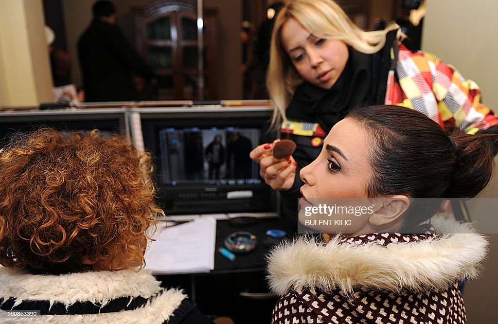 A woman applies make-up on Turkish actress Songul Oden during an interview on February 6, 2013, in Istanbul. Oden played in ''Gumus'' (Silver), a popular Turkisk TV drama, launched in 2005 and whose final episod was watched by over 85 million people from Morocco to Syria. AFP PHOTO/BULENT KILIC