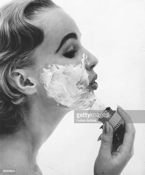 A woman applying a face mask with a shaving brush Original Publication Housewife Magazine pub 1956