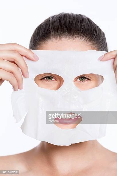 Woman applying beauty face mask