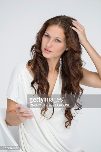 Woman applying conditioner in her hair