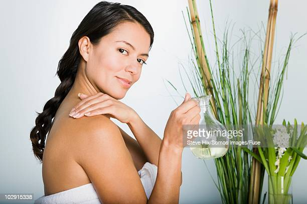 Woman applying essential oil