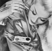 A woman applying eyeliner that is mixed with water and then put on the eyelid with a brush circa 1940's