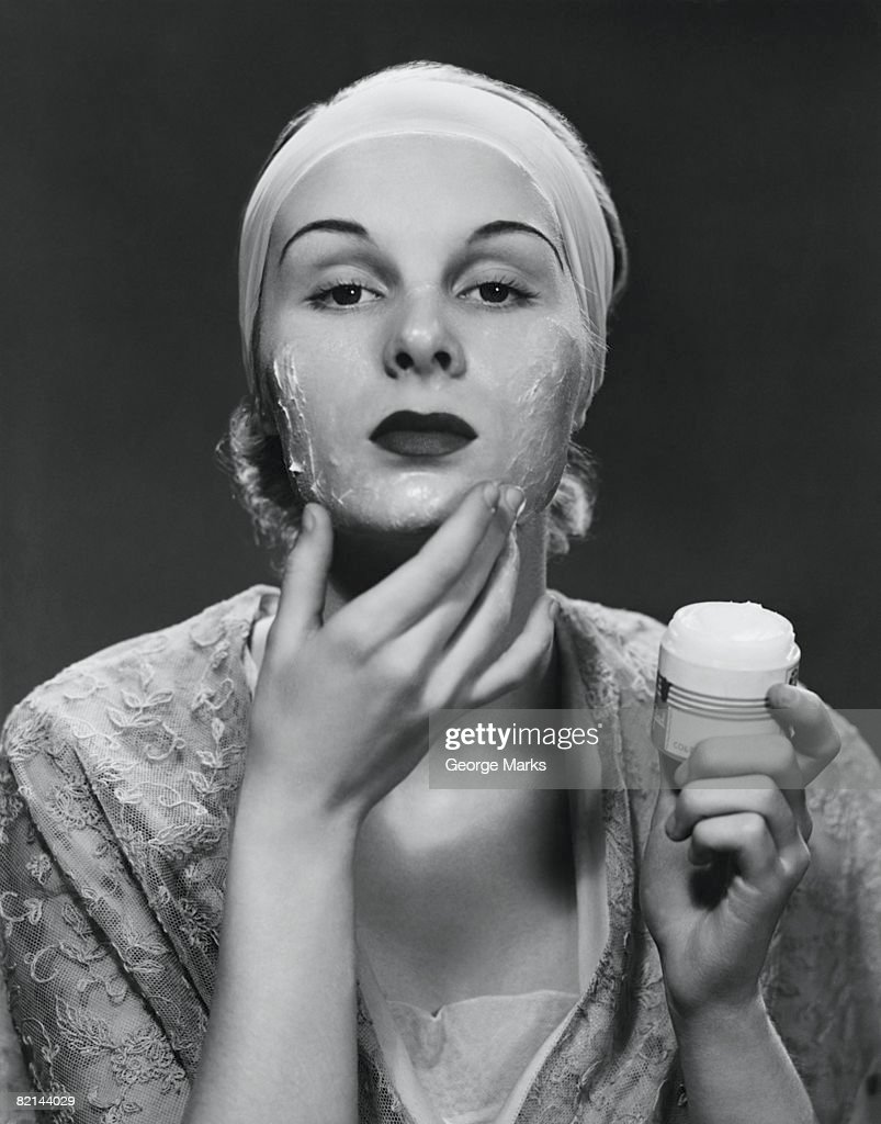 Woman applying face cream, (B&W) : Stock Photo