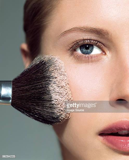 Woman applying face powder