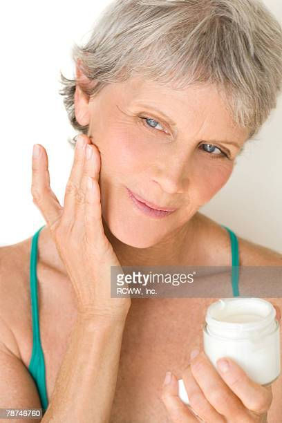 Woman Applying Facial Cream