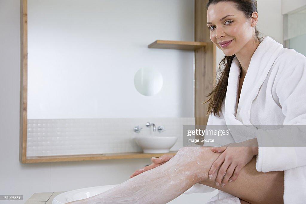Woman applying hair removal cream : Stock Photo