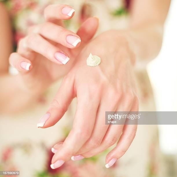 Woman applying hand creme