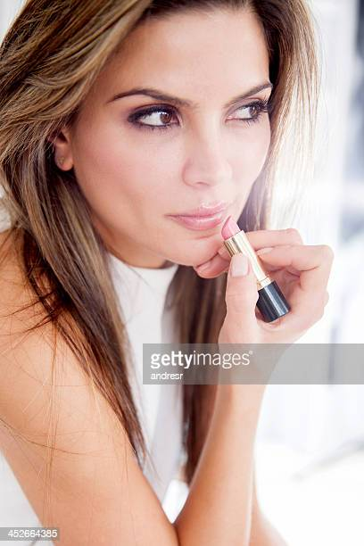Woman applying lipstick