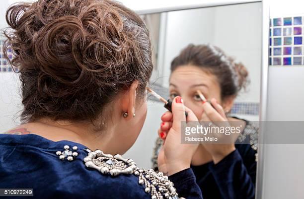 Woman applying makeup on herself