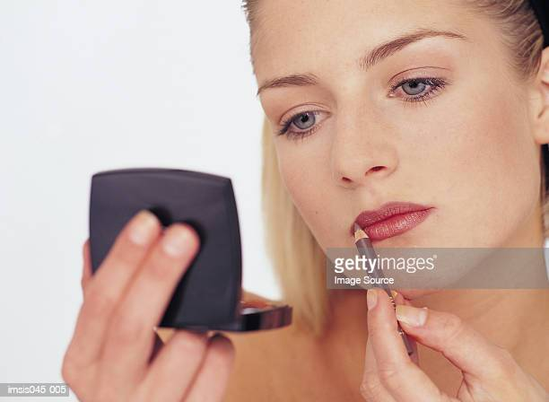 Woman Auftragen von make-up