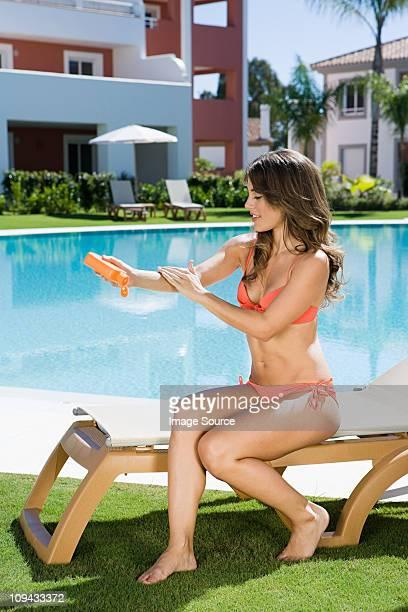 Woman applying suncream