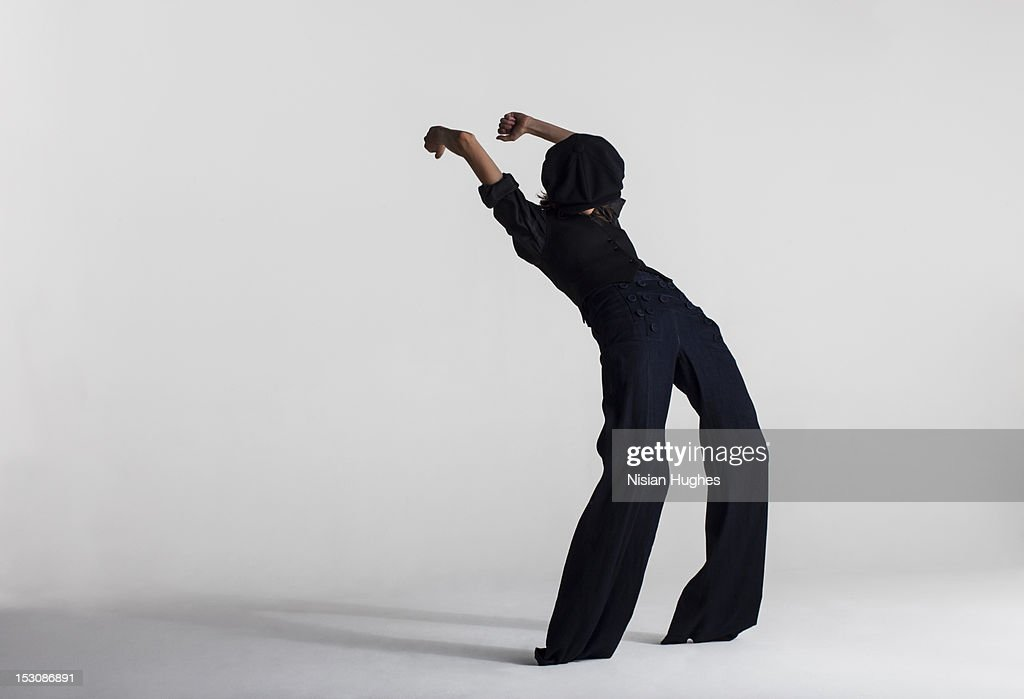 Woman arched back in jeans dancing : Stock Photo