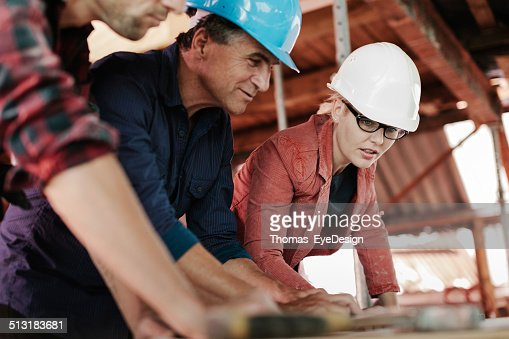 Woman Architect lookng over building Plans