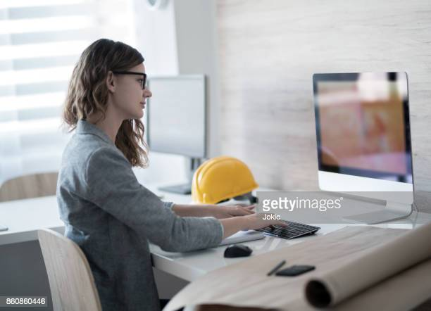 Woman architect working on a computer