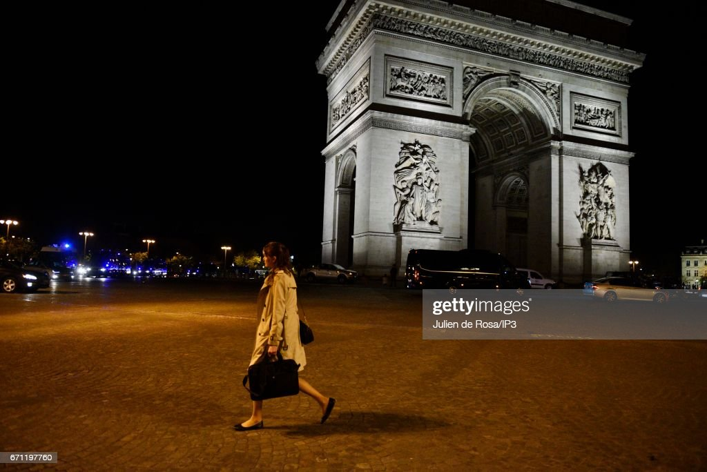 A woman Armed police secure the area after a shooting occurred on the Champs-Elysees avenue on April 20, 2017 in Paris, France. One police officer was killed and another wounded in a shooting on Paris's Champs Elysees, police said just days ahead of France's presidential election. France's interior ministry said the attacker was killed in the incident on the world famous boulevard that is popular with tourists.