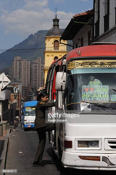 A woman army officer gets on a bus in Candeleria the old part of Bogota Bogota formerly called Santa Fe de Bogota is the capital city of Colombia as...