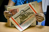A woman arranges copies of Cuban newspaper Granma official publication of Communist Party on October 9 2015 in Havana In 1992 the Granma newspaper...