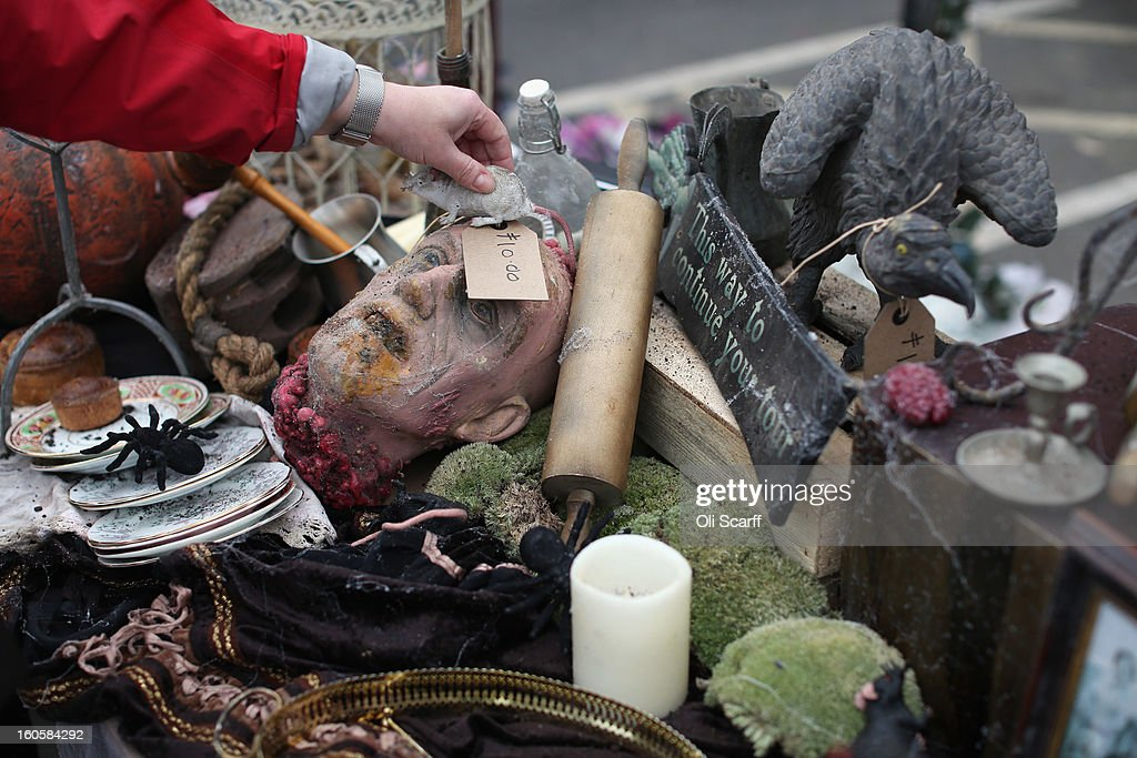 A woman arranges props previously used in 'The London Dungeon' which are to be sold at a car boot sale in Pimlico as the attraction prepares to move to new premises on the Southbank, on February 3, 2013 in London, England. The sale features a selection of torture and surgical implements, costumes, plague doctor's potions, false eyeballs, severed limbs, and a set of stocks. The London Dungeon will reopen in March 2013 in larger premises on the Thames' Southbank, having moved from Tooley Street where it originally opened 38 years ago.