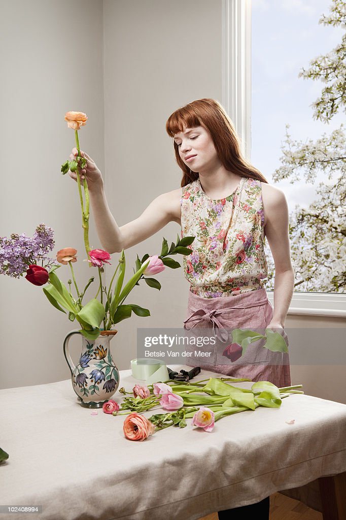 woman arranging flowers. : Stock Photo