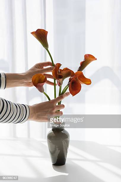 Woman arranging flowers